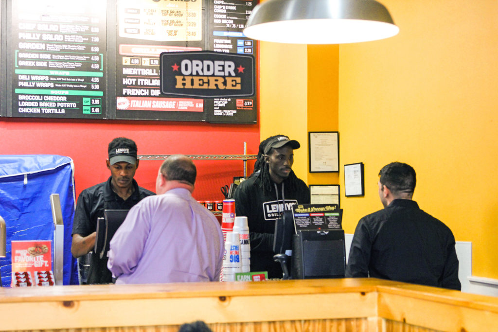 lennys subs sandwich franchise shot of employees taking orders